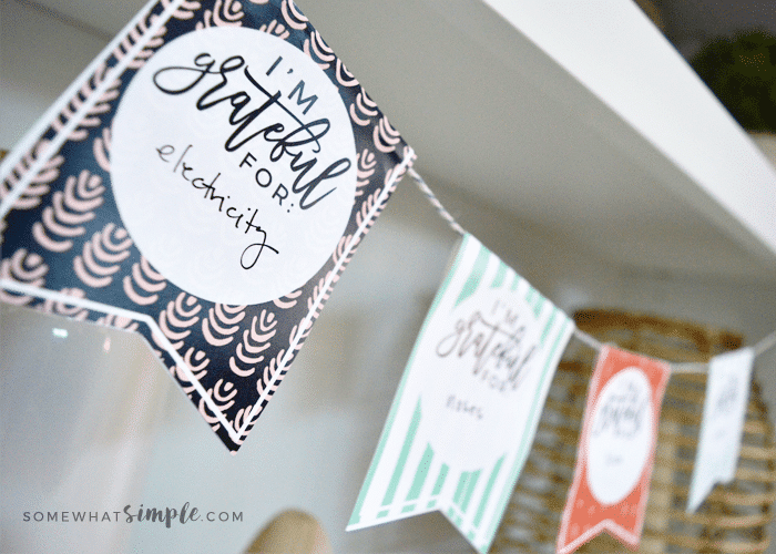 Making a gratitude banner is one of the Thanksgiving family traditions in this post.