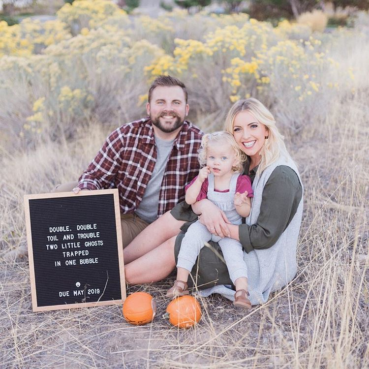 twin pregnancy reveal with letter board