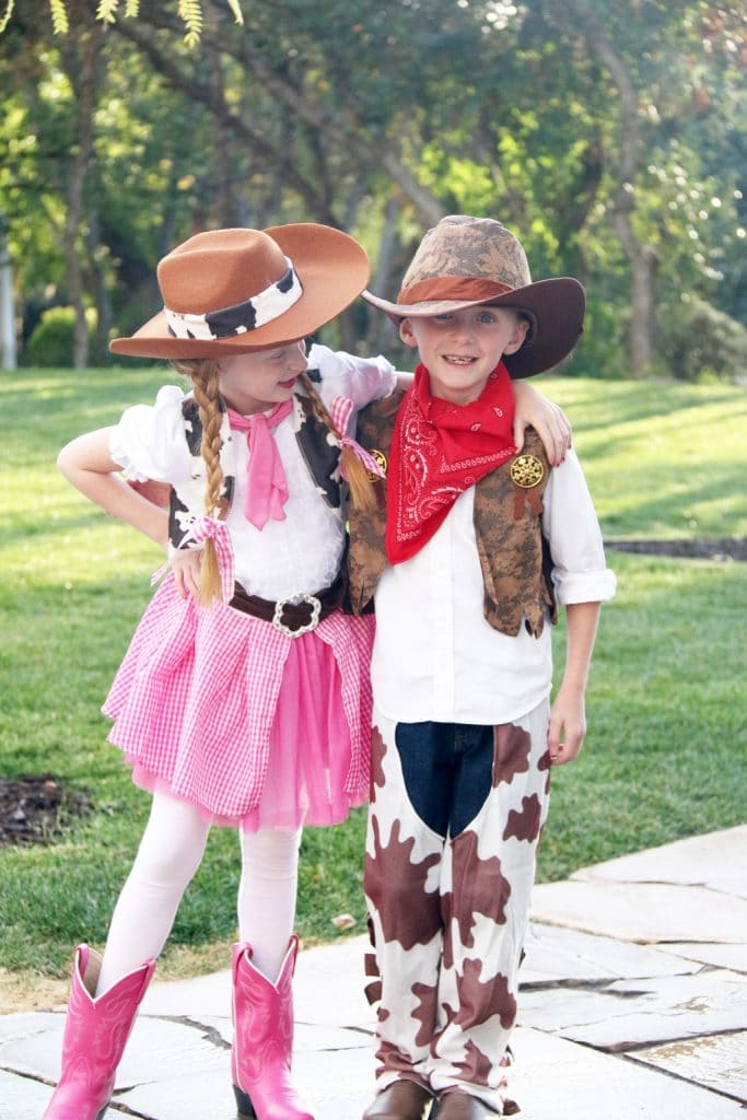 Twins dressed up as a cowboy and cowgirl for Halloween.