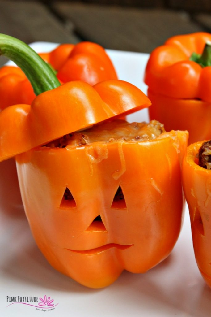Making jack-o-lantern stuffed peppers for dinner is an excellent Halloween tradition.