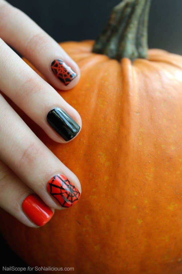 This spider web nail design is one of the Halloween nail art ideas in this post.
