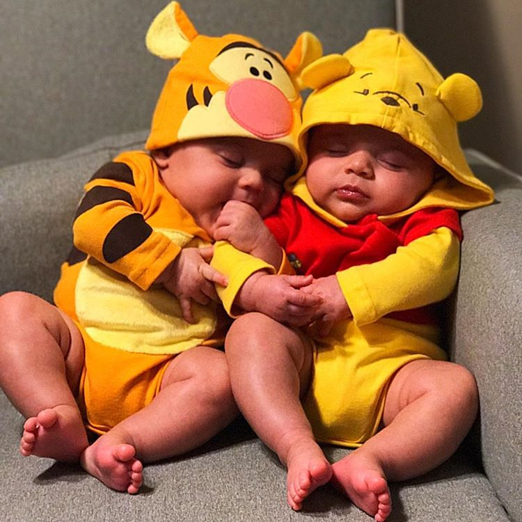 Dress up your twins as Winnie The Pooh and Tigger for Halloween this year.