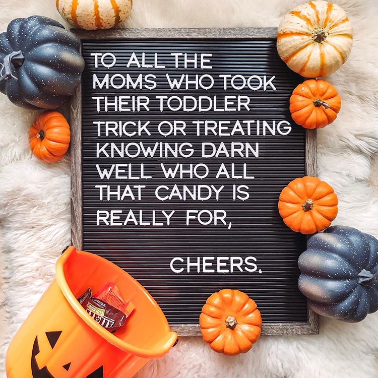"Letter board that says ""to all the moms who took their toddler trick or treating knowing darn well who all that candy is really for, cheers"""