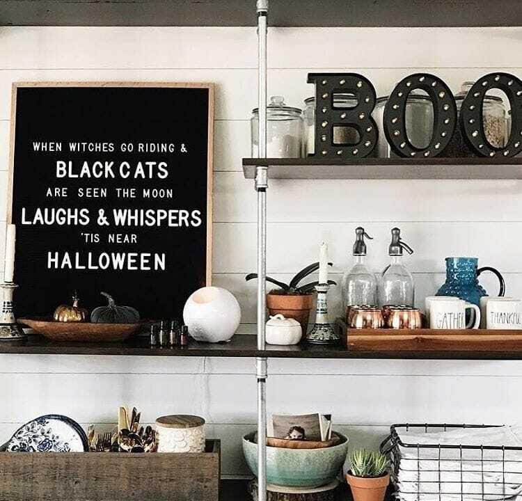 "Letter board that says ""when witches go riding & black cats are seen the moon laughs & whispers 'tis near halloween"""