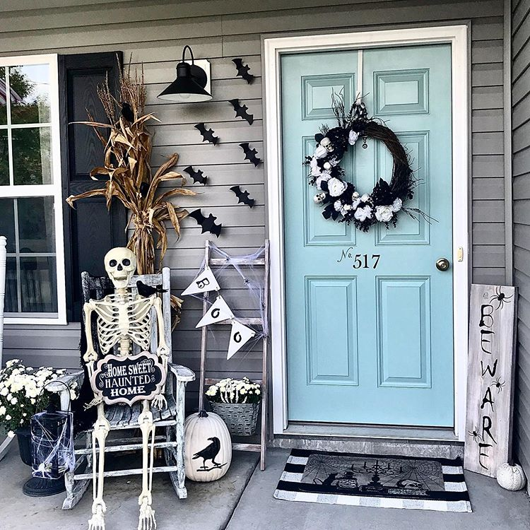 Halloween door area decorated with bats and a skeleton