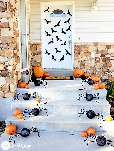 Halloween porch with bats, pumpkins, and spiders
