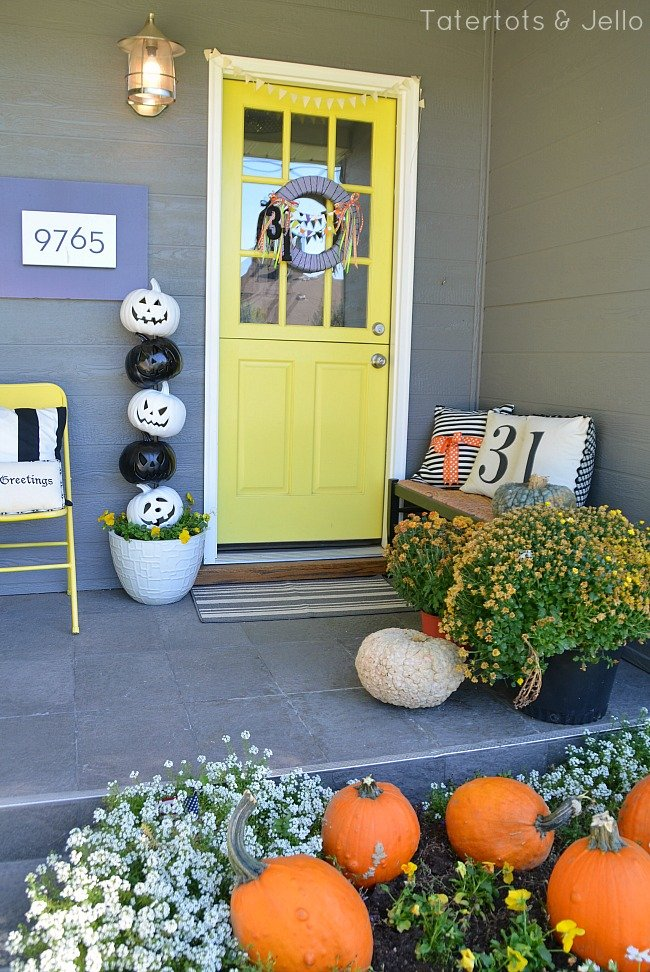 Decorate porch with black and white pumpkins