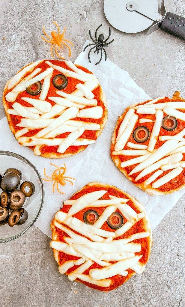 This recipe for mummy pizzas is one of the halloween meals for kids in this post