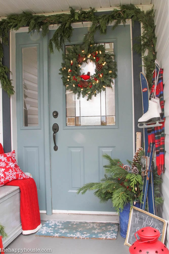 Decorate your porch with skis and ice skates for Christmas