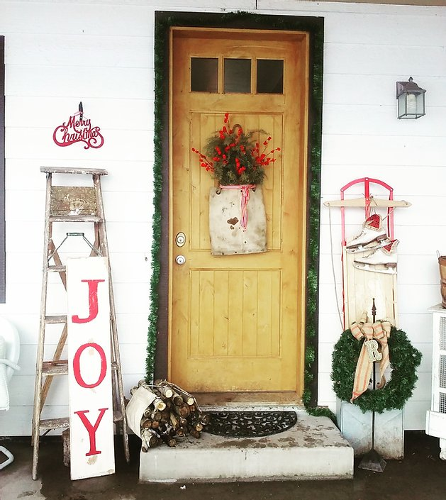 This vintage porch with pops of red is one of the Christmas porch ideas in this post.