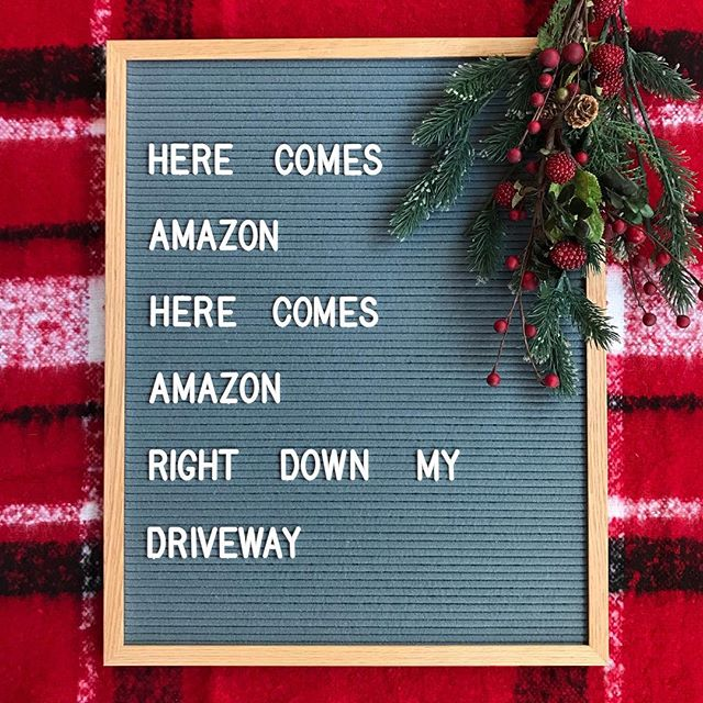 "letter board that says ""here comes amazon here comes amazon right down my driveway"""