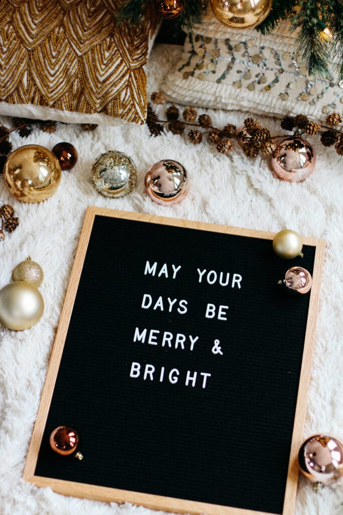 "letter board that says ""may your days be merry & bright"""