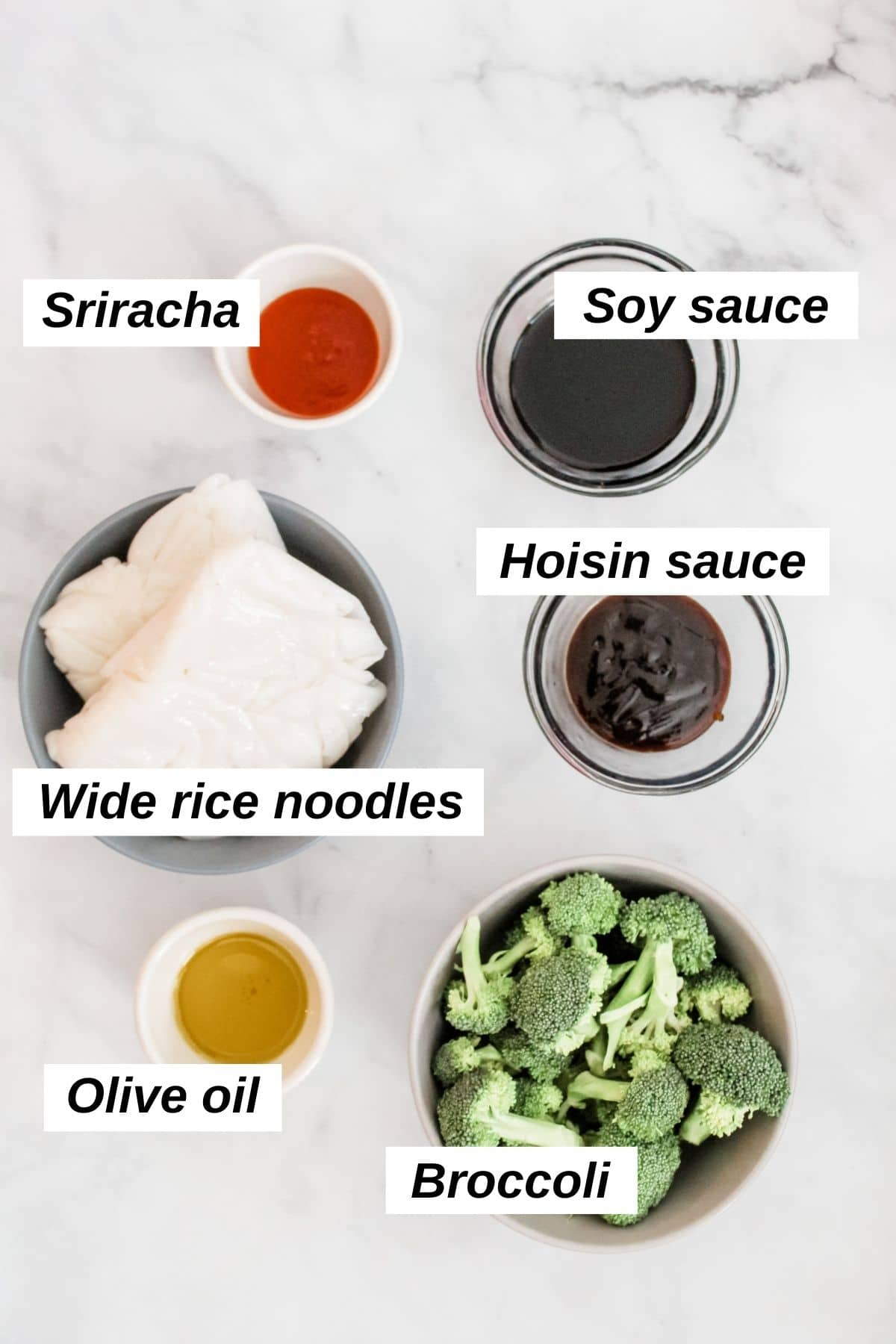 individual ingredients for vegan pad see ew, including broccoli, wide rice noodles, oil, and sauces
