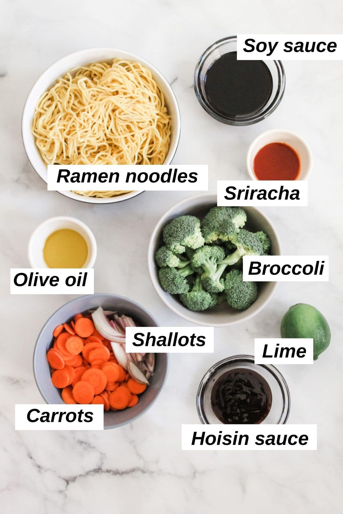 individual ingredients for stir fry vegan ramen on a marble background