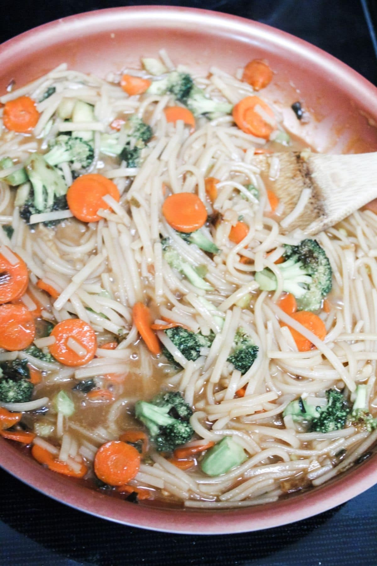 mix all of the pad thai ingredients and stirring it around in frying pan