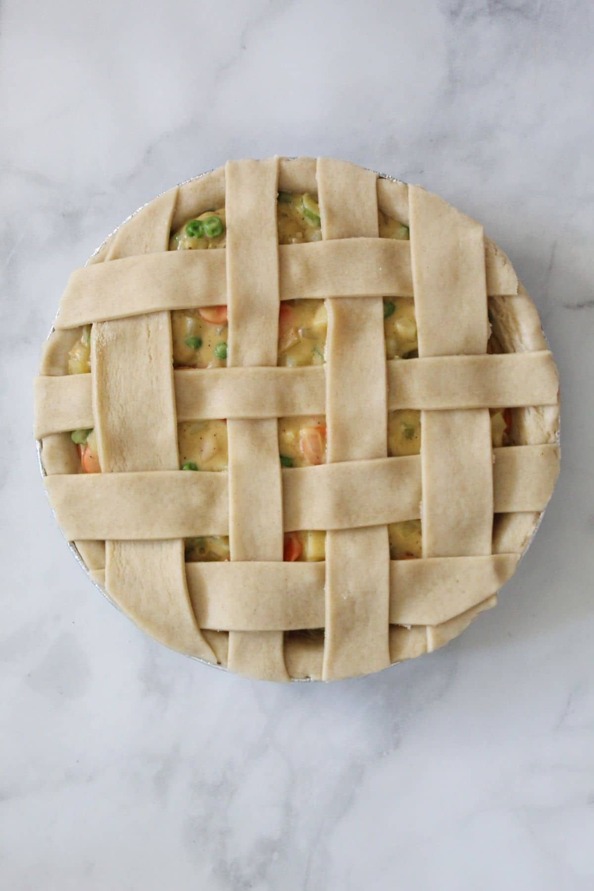pot pie with lattice top ready to go into the oven to bake