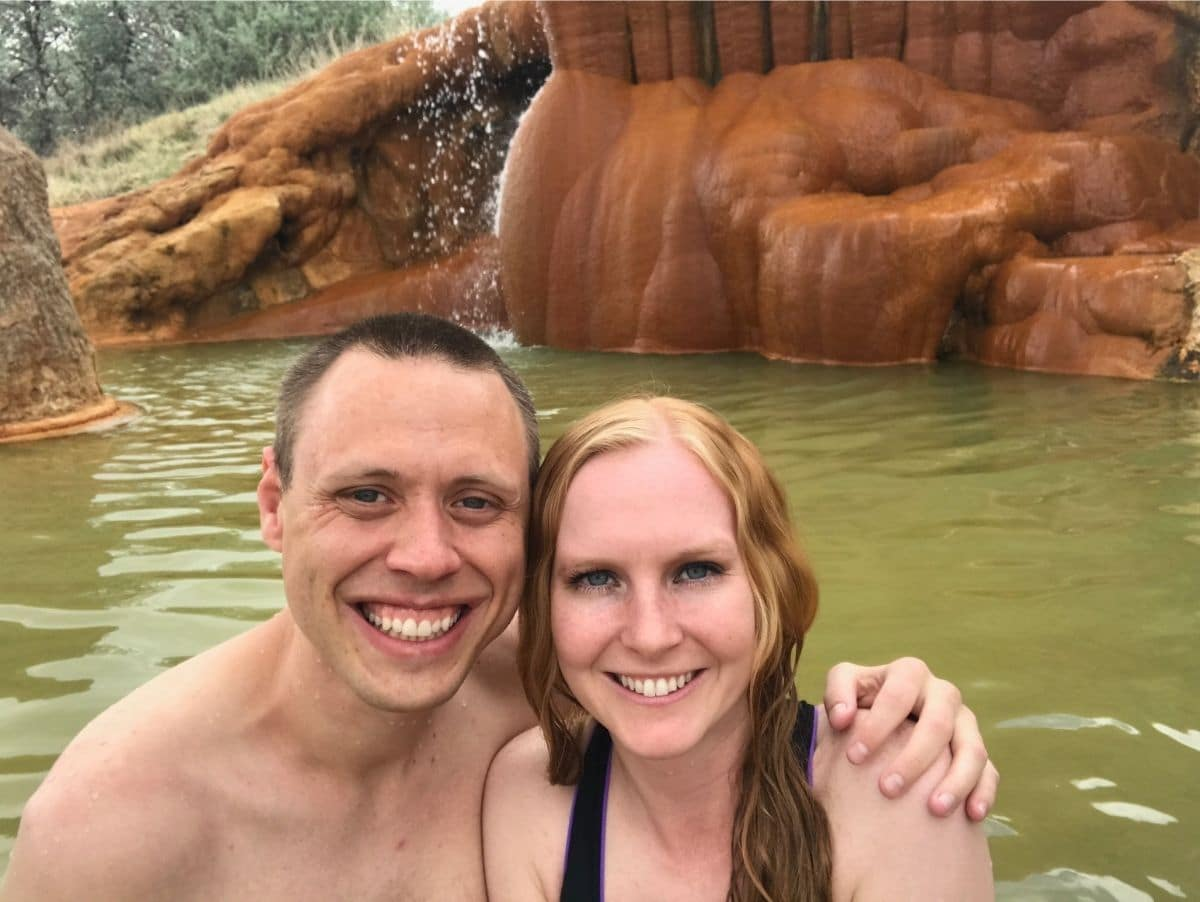 adam and liz in one of hot pools at mystic hot springs