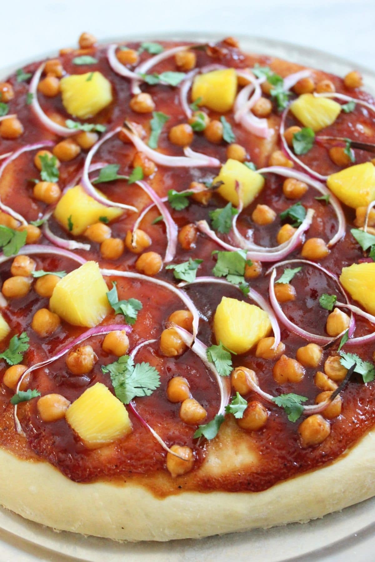 close up view of completed vegan bbq pizza finished with fresh cilantro