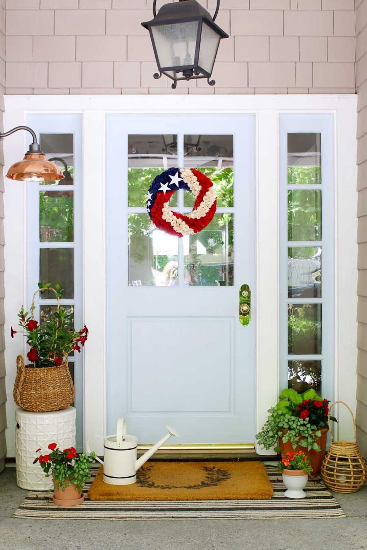 porch with red flowers and 4th of july wreath