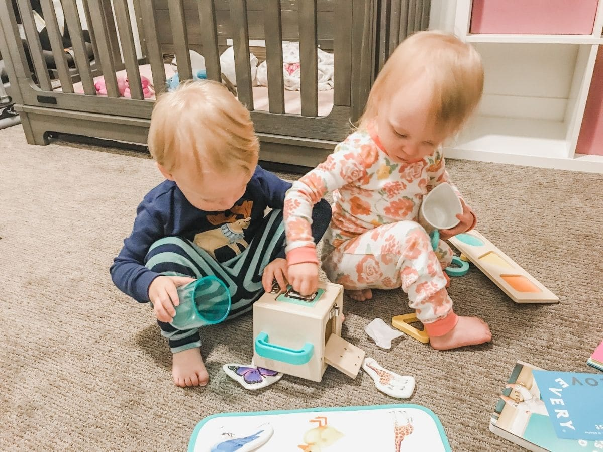 toddlers playing with lovevery lockbox