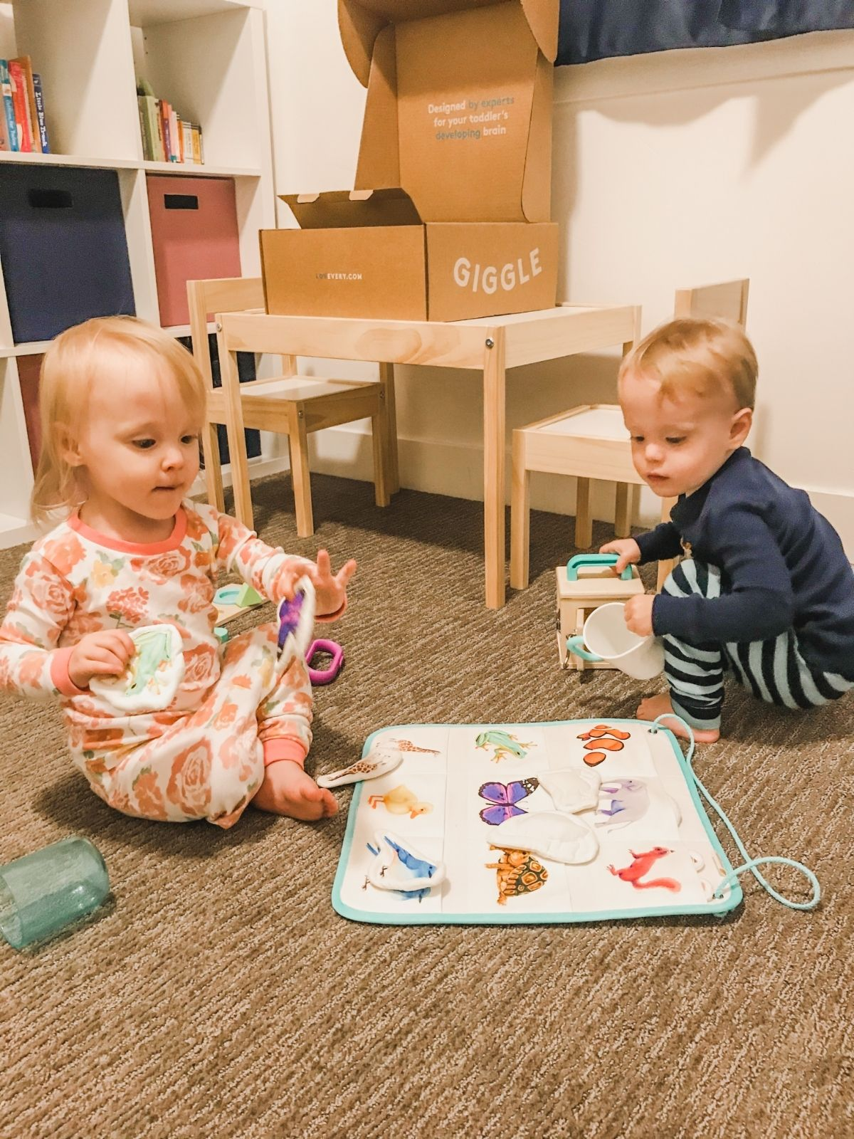 twins playing with lovevery play kit