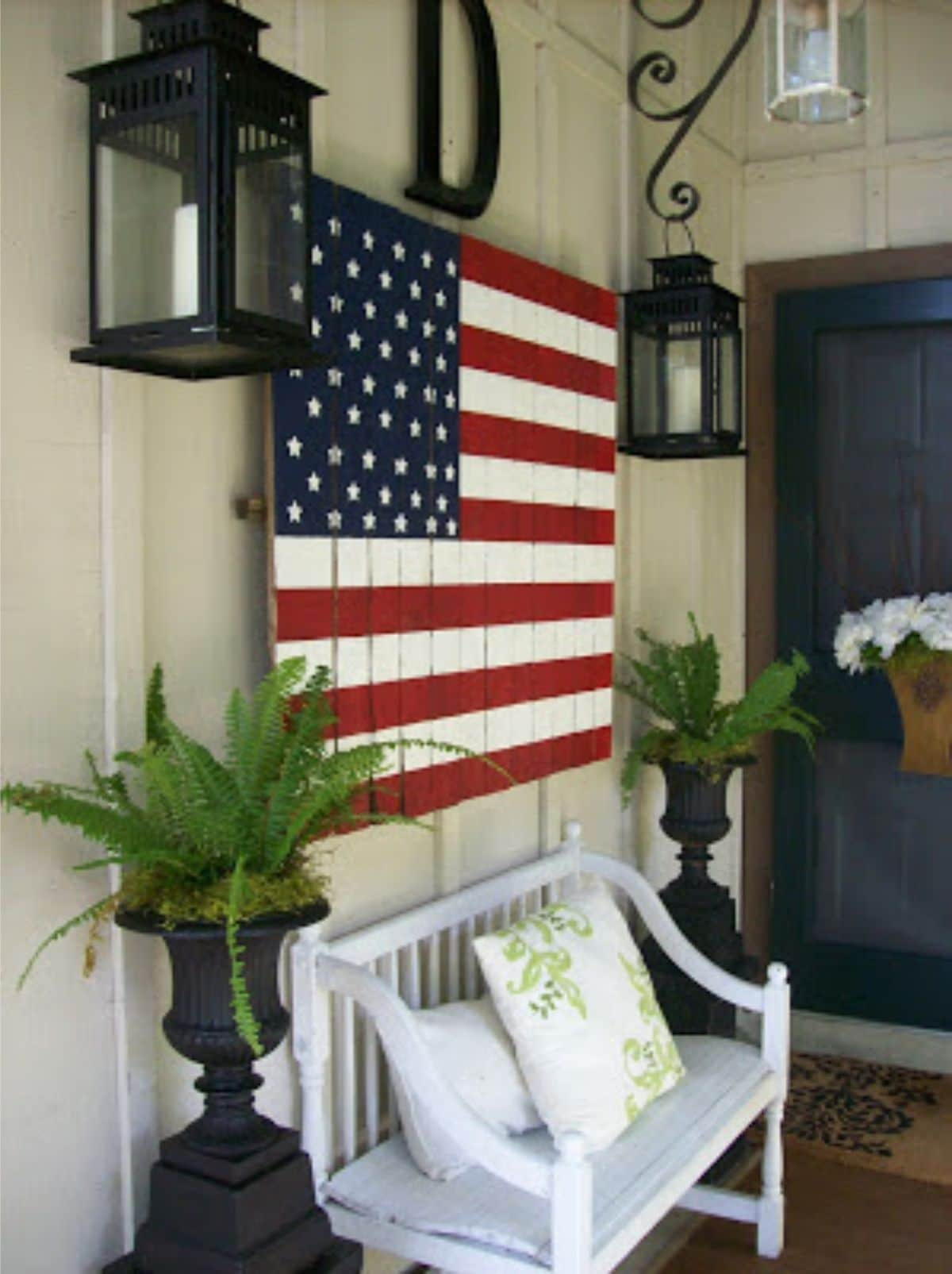 porch with big wooden american flag
