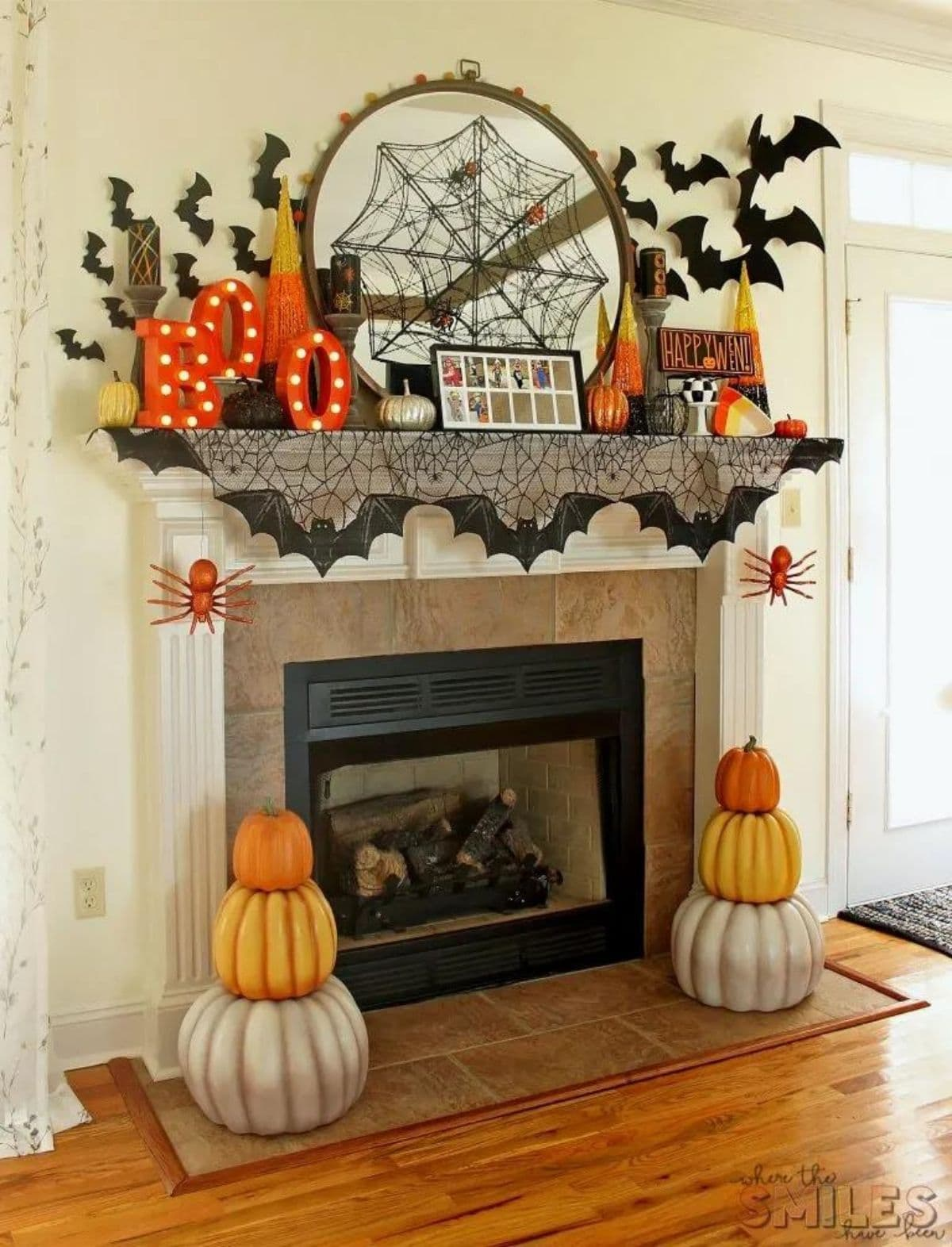 mantel with colorful pumpkins, BOO letters, bats, and spiderweb
