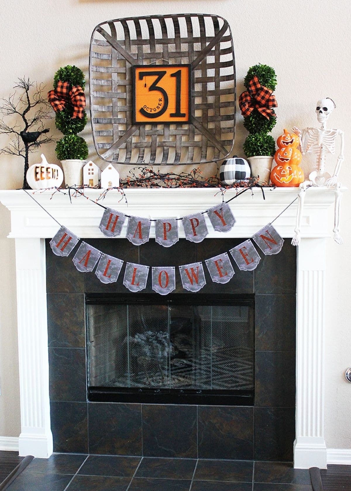 mantel with a big 31 and banner that says happy halloween