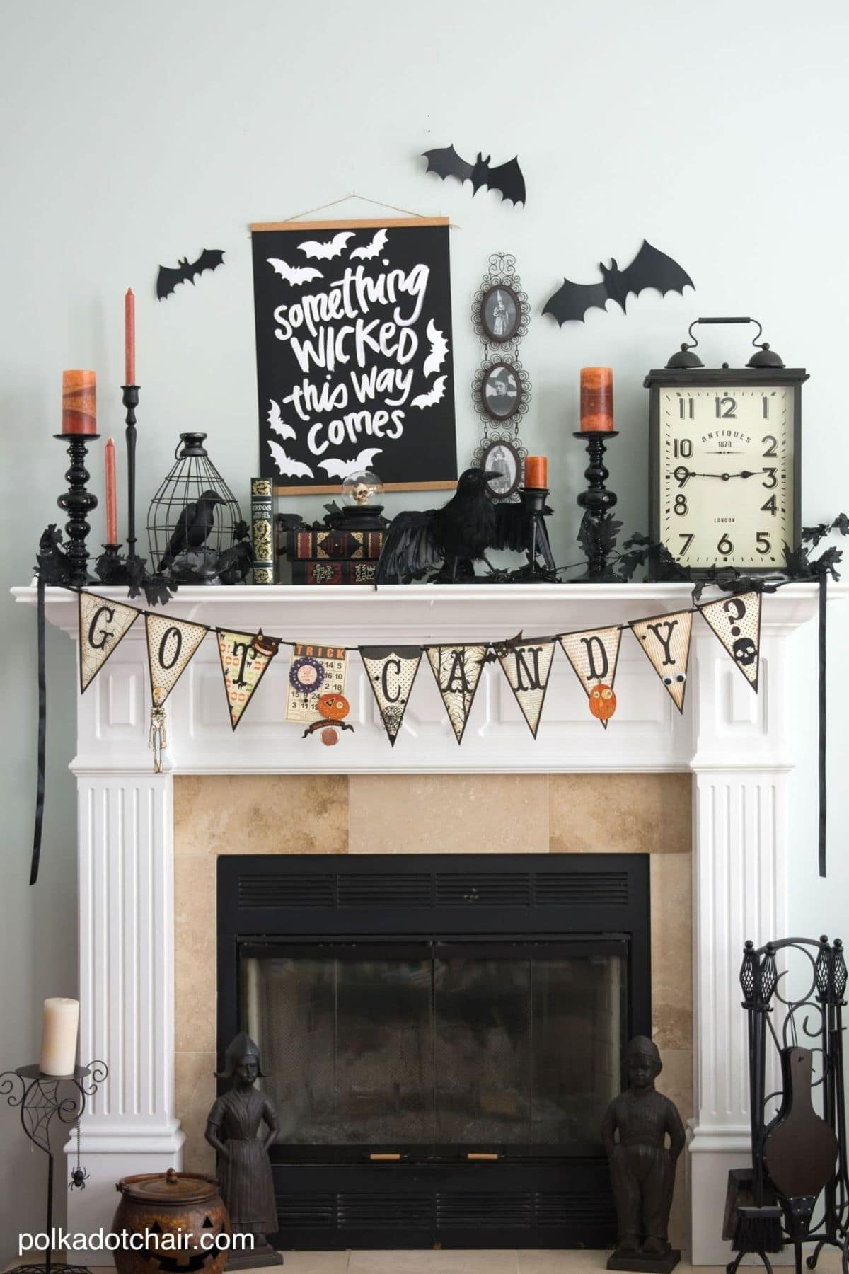 mantel with a banner that spells Got Candy and a letterboard that says Something Wicket This Way Comes