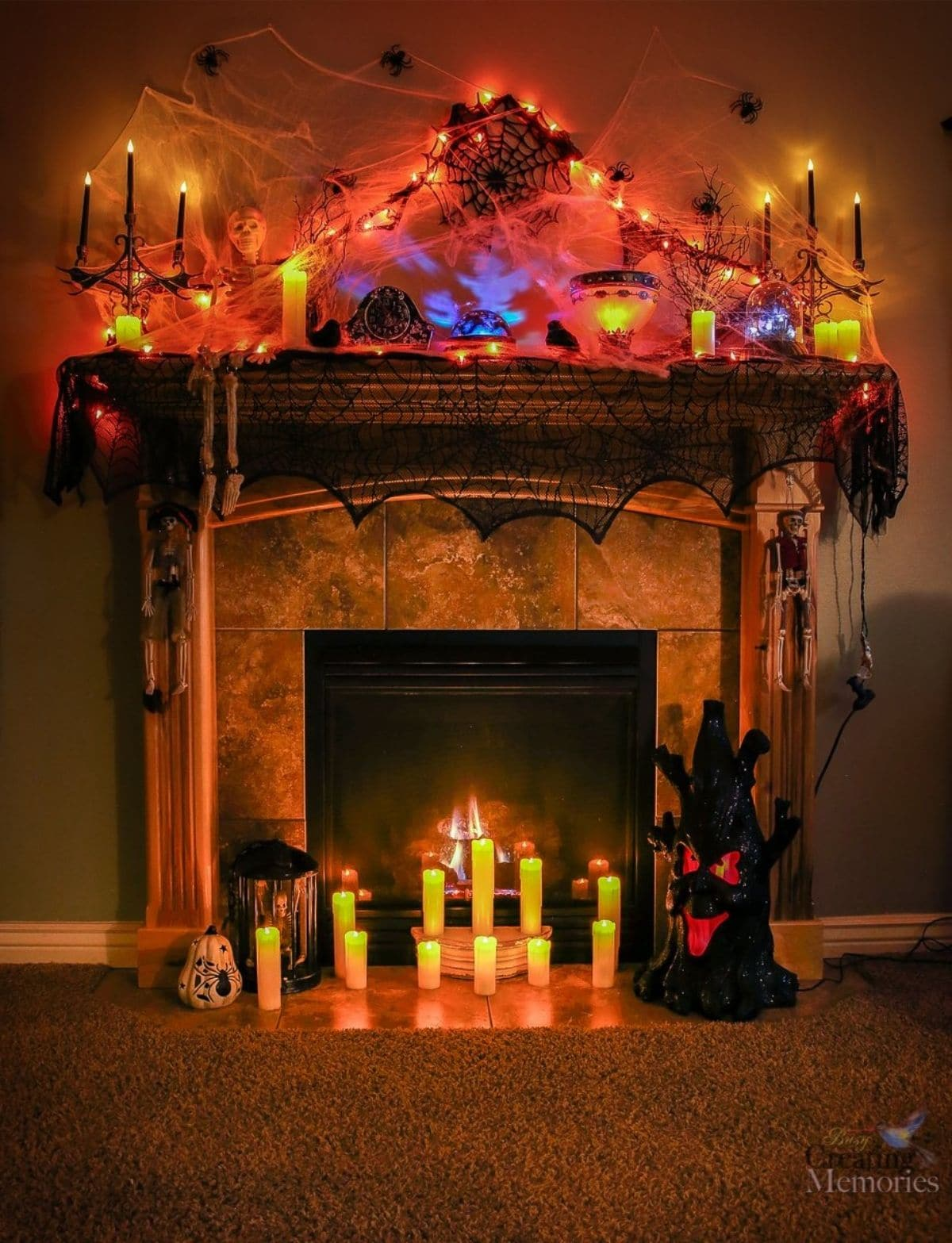 mantel all lit up with regular candles and orange lights
