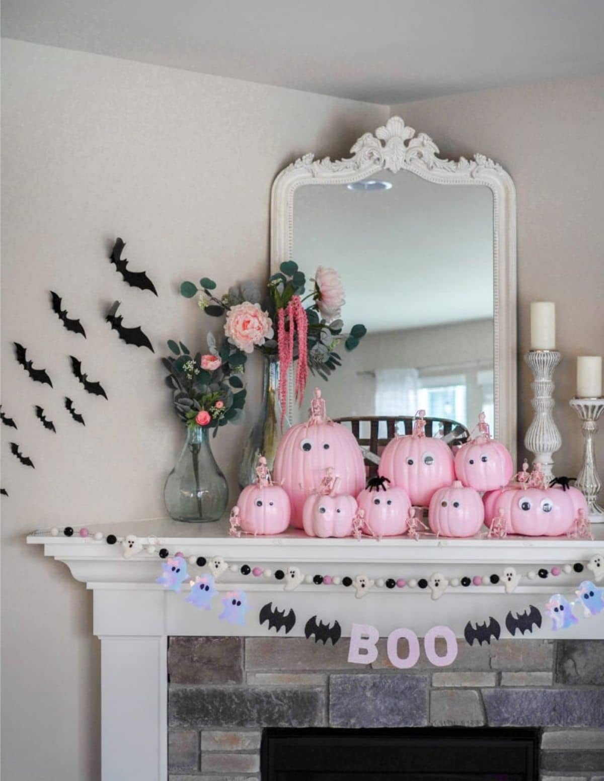 halloween mantel with pink pumpkins and Boo banner