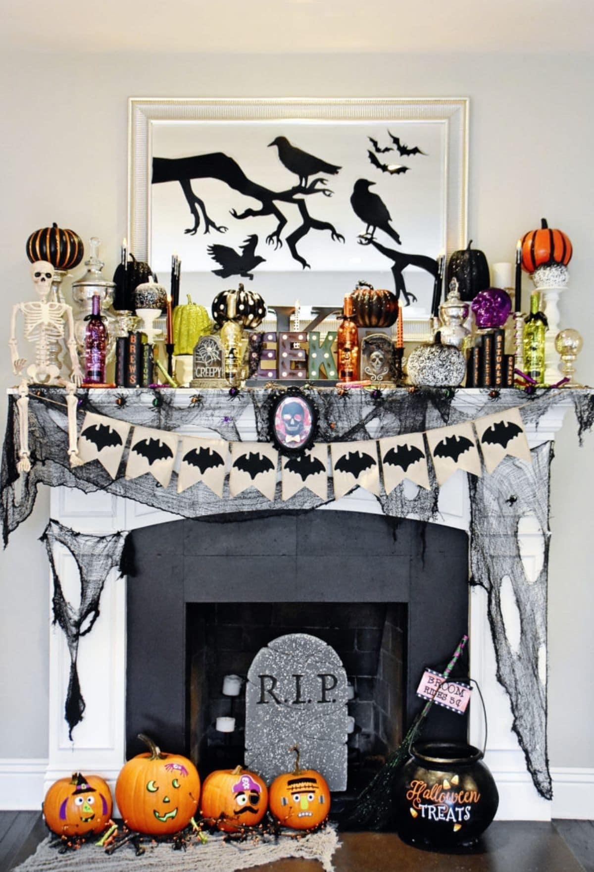 mantel with RIP headstone and lots of pumpkins