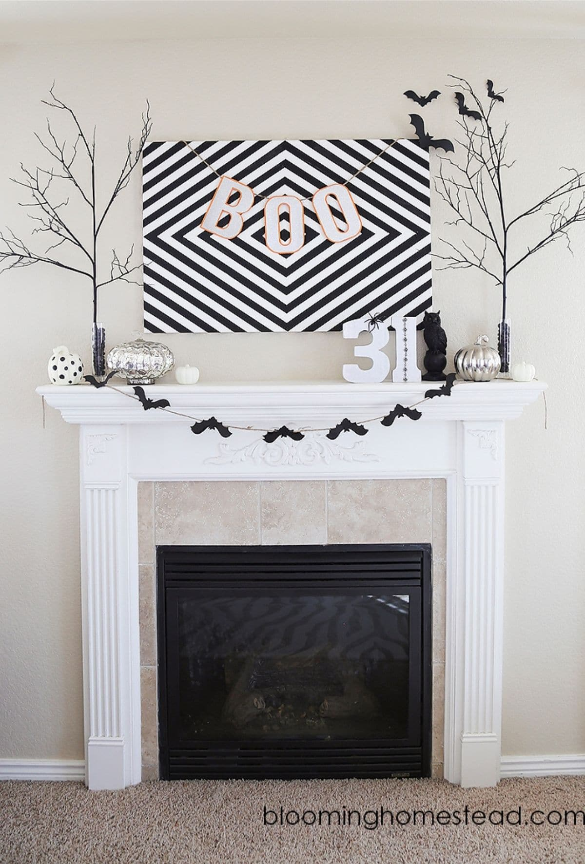 mantel with bat banner, trees, 31, and picture that says BOO