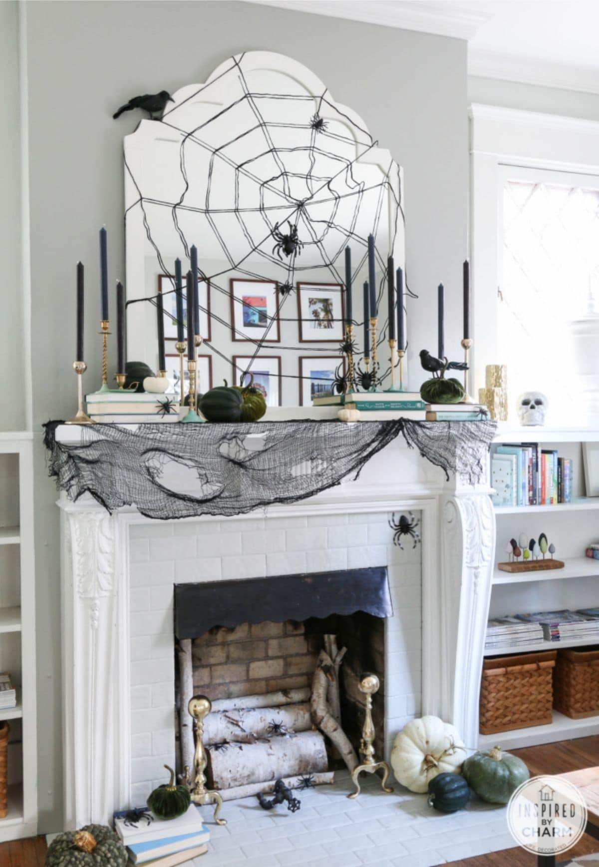mantel with black spiders, black candles, and a big spiderweb