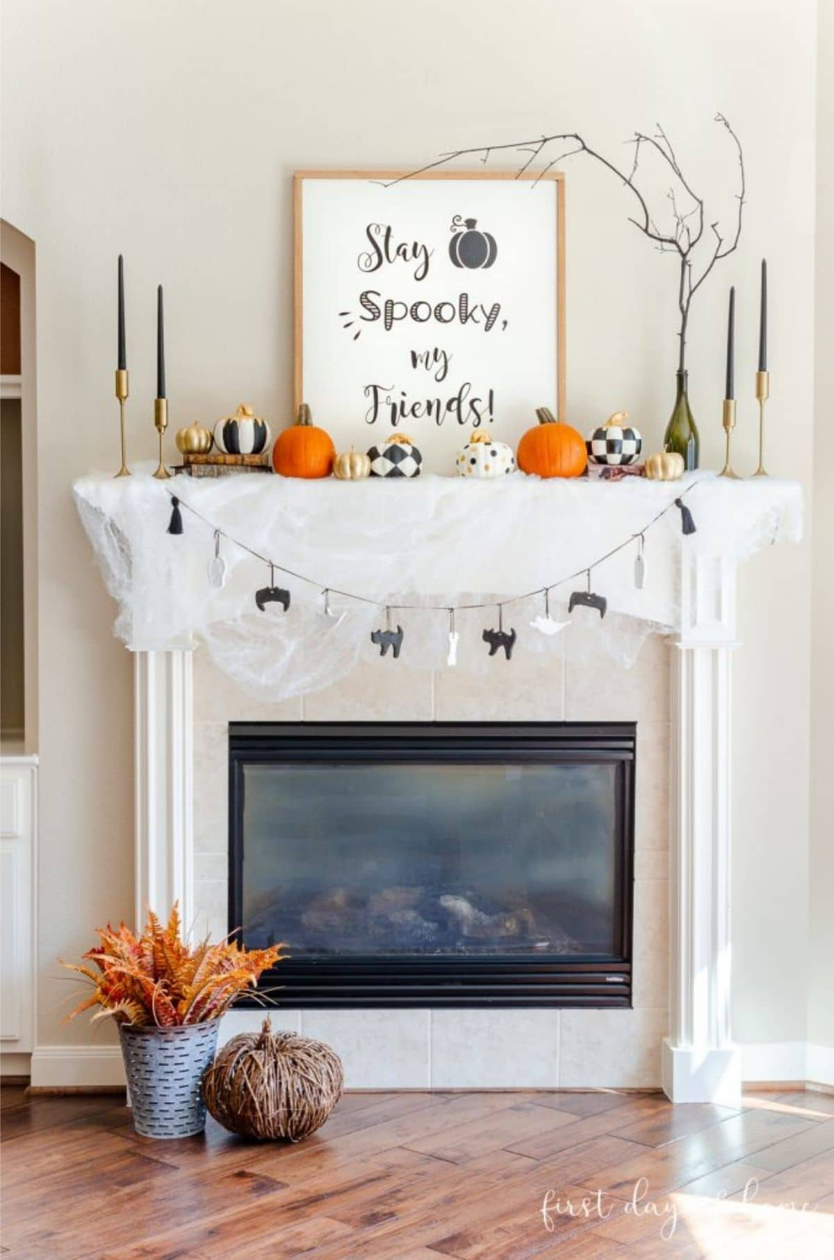 mantel with picture that says Stay Spooky my Friends